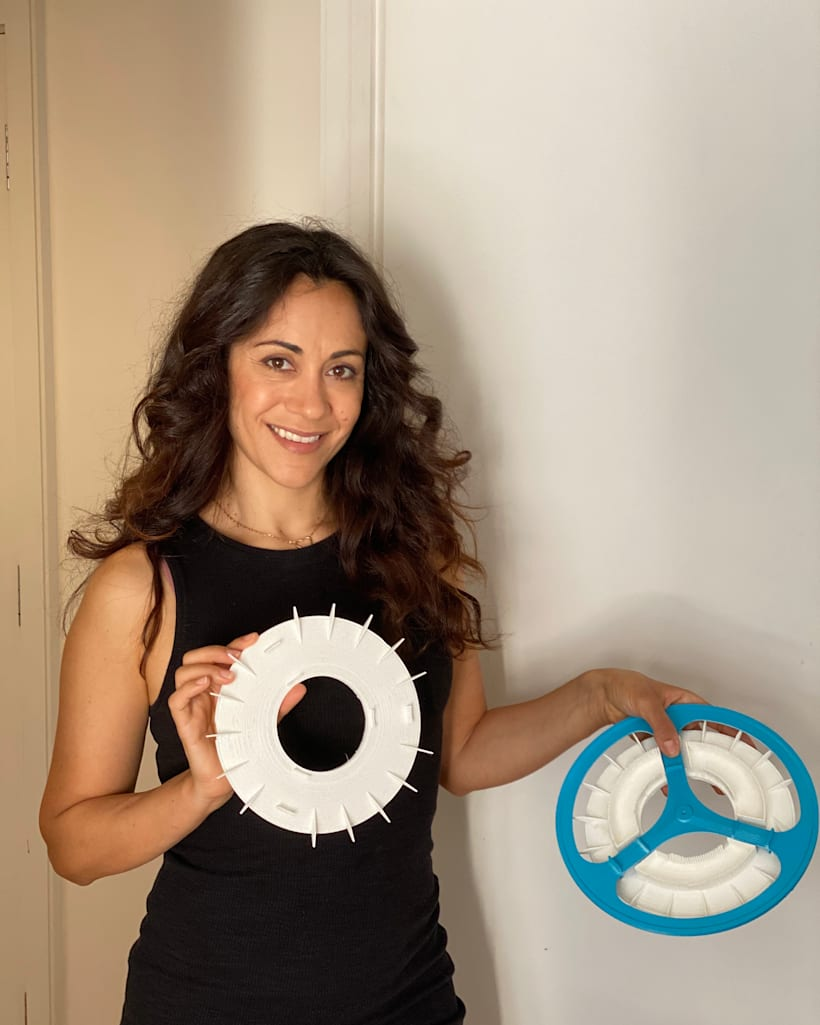 Picture: Kristen Tapping, an industrial design graduated from London Southbank University holding the Rolloe prototype. Her award-winning invention, Rolloe Roll Off Emissions, transforms the humble bicycle wheel into an air purifier that sucks in polluted air, filters out the pollutants, and releases the clean air back out into the world. So far, this would be one of the greenest ways to truly travel carbon-negative.